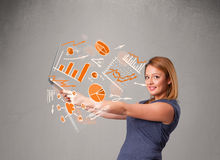 Beautiful lady holding notebook with graphs and statistics Stock Photo