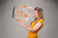 Beautiful lady holding notebook with graphs and statistics Royalty Free Stock Images