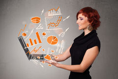 Beautiful lady holding notebook with graphs and statistics Royalty Free Stock Photos