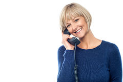 Beautiful lady holding phone receiver Stock Photography