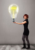 Beautiful lady holding realistic 3d light bulb Stock Photography