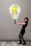Beautiful lady holding realistic 3d light bulb Stock Photo