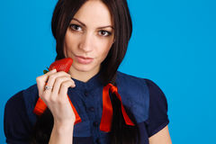 Beautiful lady holding a strawberry Royalty Free Stock Photo