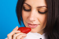 Beautiful lady holding a strawberry Stock Images