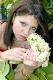 Beautiful lady with a hydrangea Stock Photos
