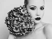 Beautiful lady with hydrangea Stock Image
