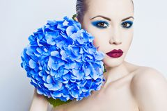 Beautiful lady with hydrangea Royalty Free Stock Image