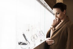 Beautiful lady in jewellery. ambient light stock image