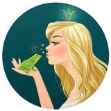 Beautiful lady kisses a frog Royalty Free Stock Image