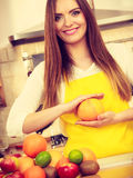 Beautiful lady in kitchen. Stock Photography