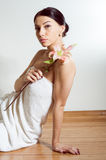 Beautiful lady with lilly flower. Perfect skin Stock Photography