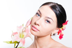 Beautiful lady with lilly flower. Perfect skin. Stock Photos