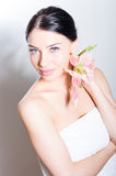 Beautiful lady with lilly flower. Perfect skin. stock photography