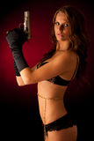 Beautiful lady in lingerie  with gun Stock Images
