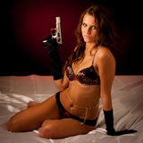 Beautiful lady in lingerie  with gun Stock Image