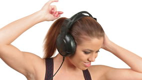 Beautiful lady listening music in large headphones, looking at camera stock video footage