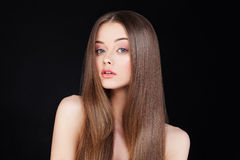 Beautiful Lady with Long Hair. On Black Background Stock Photography