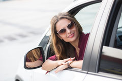 Beautiful lady looking away from her car Royalty Free Stock Images