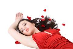 Beautiful lady lying in rose petals Stock Photos