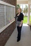 Beautiful Lady At Mail Box Stock Image
