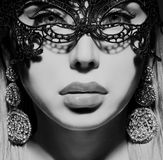 Beautiful lady in mask Stock Image