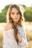 Beautiful lady model in field at sunrise Stock Images