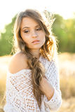 Beautiful lady model in an open field at sunrise Royalty Free Stock Photo
