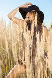 Beautiful lady model walking through meadow wilds Royalty Free Stock Photos