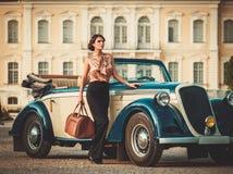 Beautiful lady near classic convertible Royalty Free Stock Image