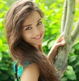 Beautiful lady near the tree Stock Photos