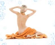 Beautiful lady with orange towels stock image