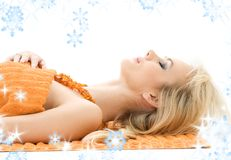 Beautiful lady with orange towels Royalty Free Stock Photo