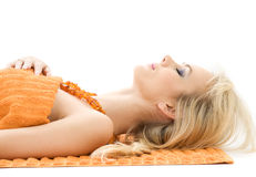 Beautiful lady with orange towels Royalty Free Stock Photos