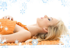 Beautiful lady with orange towels Stock Photos