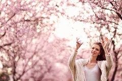 Beautiful Lady in the park in spring time Stock Photo