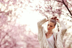 Beautiful Lady in the park in spring time Royalty Free Stock Image