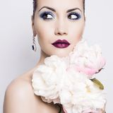 Beautiful lady with peonies Stock Images