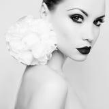 Beautiful lady with peony. Fashion portrait of beautiful young lady with peony Royalty Free Stock Photo