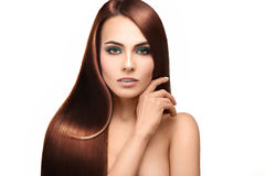 Beautiful lady with perfect straight hair looking at camera on w Stock Photos