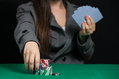 Beautiful lady playing Blackjack in casino. Blackjack In A Casino, A Lady Makes A Bet, And Puts Chips Royalty Free Stock Image