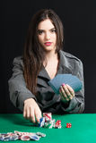 Beautiful lady playing Blackjack in casino. Blackjack In A Casino, Lady Makes A Bet, And Puts Chips Stock Images