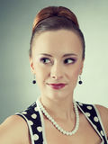 Beautiful lady in a polka dot dress. Royalty Free Stock Photography