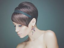 Beautiful lady. Portrait of young beautiful lady with earring Royalty Free Stock Photos