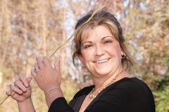 Beautiful lady posing holding onto guidewire stock photography