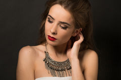 Beautiful lady posing with necklace in studio Stock Photos