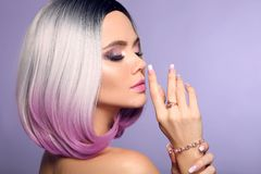 Beautiful lady presents amethyst ring and bracelet jewelry set. Woman portrait with ombre bob short hairstyle and manicured nails royalty free stock images