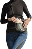 Beautiful lady pulls out bundle of euro banknotes from handbag Royalty Free Stock Photo