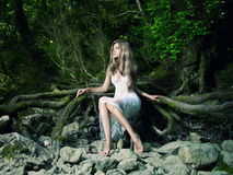Beautiful lady in the rainforest stock photo