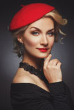 Beautiful lady in red beret Stock Photography