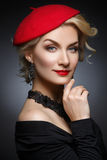 Beautiful lady in red beret Stock Images
